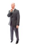 Businessman with finger on lips Royalty Free Stock Images