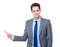 Businessman with finger point side Royalty Free Stock Images