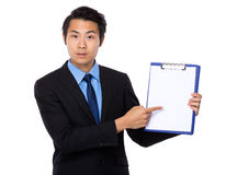Businessman finger point to clipboard Royalty Free Stock Photo