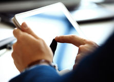 Businessman finger pointing to the screen of a tablet Royalty Free Stock Photography