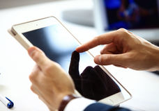 Businessman finger pointing to the screen of a tablet Stock Photography