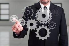 Businessman finger touching a modern digital gear on touchscreen Stock Photography