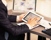 Businessman with finger touching screen of a digital tablet Stock Photography