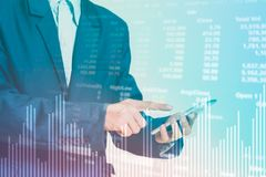 Profit graph of stock market trade indicator financial. Businessman finger touching smart phone with finance and banking profit graph of stock market trade Stock Photography