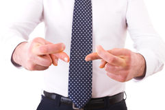 Business man with fingers crossed. Stock Image