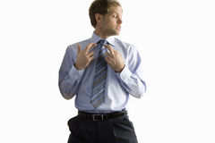 Businessman with fingers crossed Stock Image