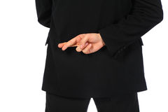 Businessman with fingers crossed behind his back. On white Royalty Free Stock Photography