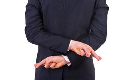 Businessman with fingers crossed. Royalty Free Stock Images