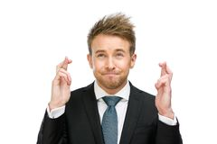 Businessman with fingers crossed Royalty Free Stock Photo