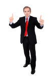 Businessman with fingers up Stock Images
