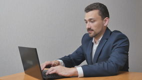 Businessman finishes work on laptop stock footage