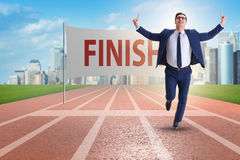 The businessman on the finishing line in competition concept Stock Image