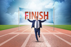 The businessman on the finishing line in competition concept Royalty Free Stock Image