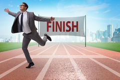 The businessman on the finishing line in competition concept Royalty Free Stock Images