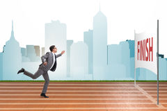The businessman on the finishing line in competition concept Royalty Free Stock Photos