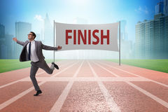 The businessman on the finishing line in competition concept Stock Photos