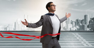 The businessman on the finishing line in competition concept Stock Photo