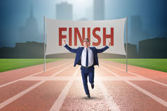 The businessman on the finishing line in competition concept Stock Images
