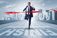 The businessman on the finishing line in competition concept Royalty Free Stock Photography
