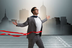 The businessman on the finishing line in competition concept Royalty Free Stock Photo