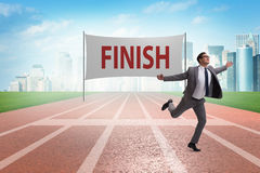 The businessman on the finishing line in competition concept. Businessman on the finishing line in competition concept Royalty Free Stock Images