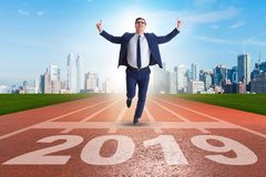 The businessman on finishing line in race for 2019. Businessman on finishing line in race for 2019 stock photo