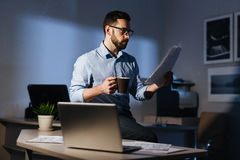 Businessman Finishing Work Late at Night royalty free stock photography