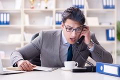The businessman during fire alarm in office Royalty Free Stock Photo