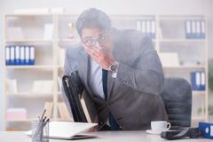 The businessman during fire alarm in office Royalty Free Stock Image
