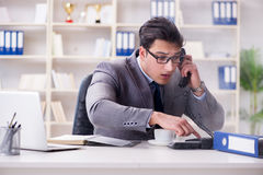 The businessman during fire alarm in office Stock Photography