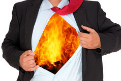 Businessman on fire. Body of businessman with open shirt revealing burning fire, burnt out concept on white background Royalty Free Stock Images