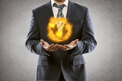 Businessman with fire Stock Photo