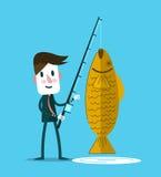 Businessman fishing a big golden fish. Royalty Free Stock Image
