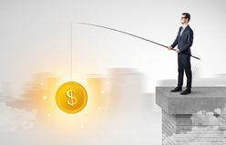 Businessman fishing coins concept Stock Image
