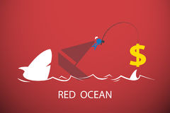 Businessman fishing dollar symbol in red ocean, business concept Royalty Free Stock Photo