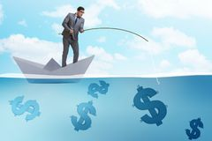 The businessman fishing dollars money from paper boat ship Royalty Free Stock Photography