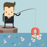 Businessman fishing money by magnet. Businessman fishing money by red magnet Royalty Free Stock Photo