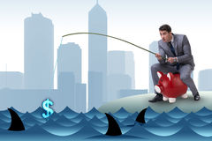 The businessman fishing out dollars from water Royalty Free Stock Images