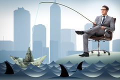 The businessman fishing out dollars from water Stock Photos