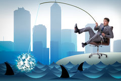The businessman fishing out dollars from water Royalty Free Stock Image