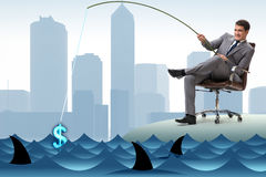 The businessman fishing out dollars from water. Businessman fishing out dollars from water Royalty Free Stock Photos