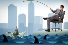 The businessman fishing out dollars from water Royalty Free Stock Photography