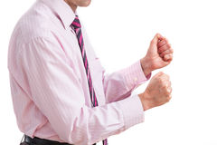 Businessman and fist clenching Stock Photo