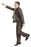 Businessman with fist forward Stock Photos