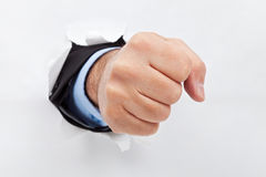 Businessman fist through the paper Royalty Free Stock Images