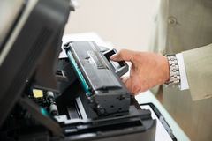 Businessman fixing cartridge in photocopy machine Royalty Free Stock Images