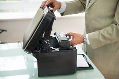 Businessman fixing cartridge in photocopy machine Stock Image
