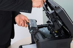 Businessman fixing cartridge in photocopy machine Stock Photography