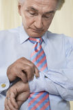 Businessman Fixing Cuff Links Stock Images