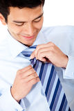 Businessman fixing his tie Stock Photo